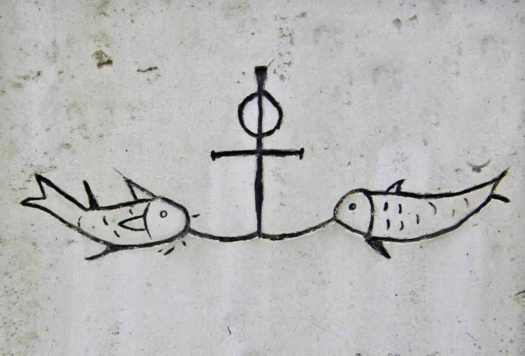 Símbolo del ancla unido al símbolo del pez